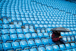 21st October 2017 - Premier League - Manchester City v Burnley - A fan sits under an umbrella as rain falls before the match - Photo: Simon Stacpoole / Offside.