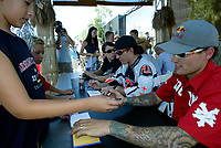 """Jul 01, 2003; Anaheim, California, USA; Moto X star athlete MIKE METZGER signs autographs at the opening of Disney's California Adventure """"X Games Experience"""".  Disney park has built two X-Arena's specifically for this 41 day event highlighting extreme sports for the launch of the 2003 ESPN X Games.<br />Mandatory Credit: Photo by Shelly Castellano/Icon SMI<br />(©) Copyright 2003 by Shelly Castellano"""