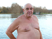 Portrait of Ian Studdart, a member of the Serpentine Swimming Club, Hyde Park, London, UK. The Serpentine Lake is situated in Hyde Park, London's largest central open space. The Serpentine Swimming Club was formed in 1864 'to promote the healthful habit of bathing in open water throughout the year'.  Its headquarters were beneath an old elm tree on the south side of the lake, a wooden bench for clothing being the only facility.  At this time London was undergoing rapid expansion and Hyde Park was now in the centre of a densely populated built up area and provided a place of relaxation to its urbanised masses. Now, the club has its own (somewhat spartan) changing facilities and members are  permitted by the Royal Parks to swim in the lake any morning before 09:30.  They race every Saturday morning throughout the year, regardless of the weather.