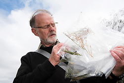 Mike Edwards of Edwards Ecology holding bags of Field cricket Gryllus campestris, part of translocation project, RSPB Farnham Heath Nature Reserve, Surrey, April