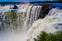 Devil's Throat, the largest of the waterfalls at Iguazu Falls (Iguacu in Portugese), on the border of Brazil and Argentina. It is one of the New 7 Wonders of Nature and is a UNESCO World Heritage Site. There are 275 waterfalls total which make up the largest waterfalls in the world.  It is on the Argentine side.