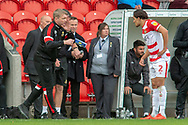 Doncaster Rovers Manager Grant McCann talks to Doncaster Rovers defender Niall Mason  during the EFL Sky Bet League 1 match between Doncaster Rovers and Bradford City at the Keepmoat Stadium, Doncaster, England on 22 September 2018.