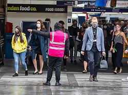 © Licensed to London News Pictures. 28/08/2020. London, UK. Commuters arrive at Victoria Station this morning as the Government announce it will launch a new push to get workers back in to city centres. Prime Minister Boris Johnson will launch a new publicity campaign next week to encourage office workers to get back to their offices while reassuring workers that the work environment is safe. Photo credit: Alex Lentati/LNP