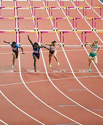 London, August 12 2017 . Sally Pearson, Australia, wins the women's 100m hurdles final ahead of Dawn Harper Nelson, USA, and Pamela Dutkiewicz, Germany, on day nine of the IAAF London 2017 world Championships at the London Stadium. © Paul Davey.