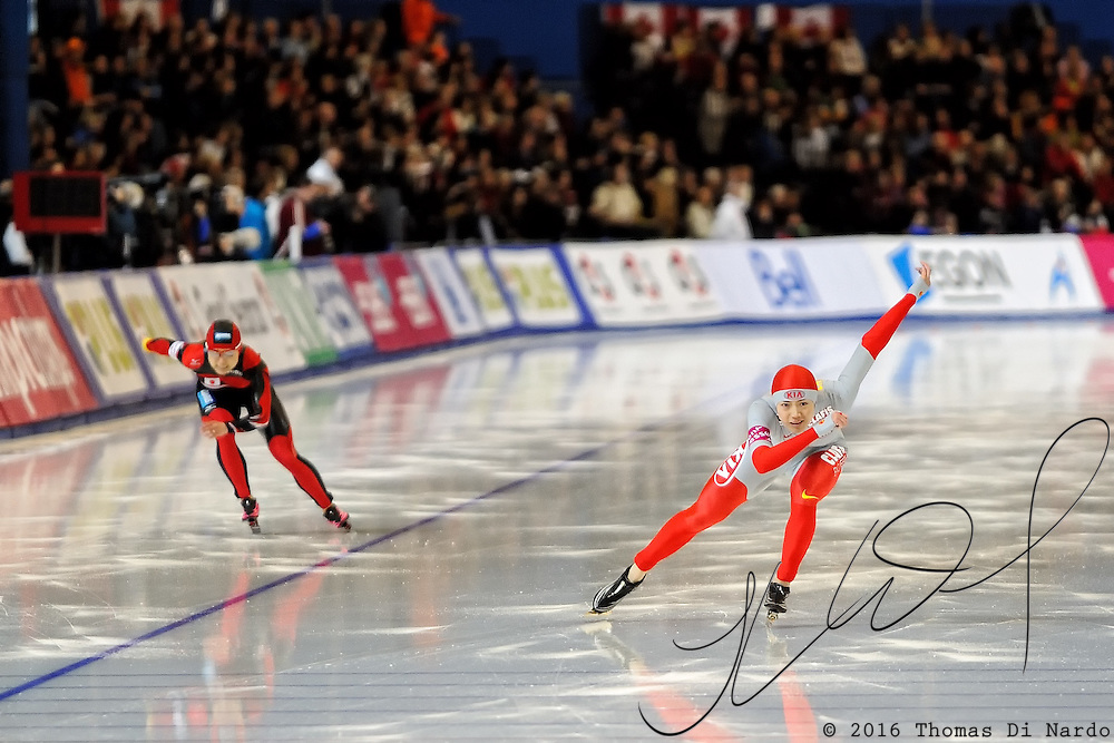 Wang Beixing (CHN) and Tomomi Okazaki (JPN) compete in the ladies 500m event at the 2009 Essent ISU World Single Distances Speed Skating Championships. Wang won one of the two races but finished in the second position overall. The winner in the 500m distance was Jenny Wolf (GER).