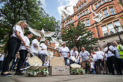 © Licensed to London News Pictures . 26/06/2017 . Manchester , UK . 22 doves are released at a short ceremony in St Ann's Square . Fire-fighters wearing symbolic Manchester bee t-shirts walk from Manchester Central Fire Station to St Ann's Square in Manchester City Centre for a short ceremony and release of 22 doves , in commemoration of the 22 people killed in a murderous terrorist attack , carried out by Salman Abedi , following an Arina Grande concert at the Manchester Arena , on 22nd May 2017 . Local fire crews have expressed frustration after they were held back from attending to support other emergency services for nearly two hours after the bombing , on the night of the attack . Photo credit : Joel Goodman/LNP