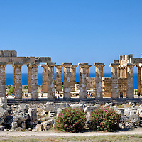 Selinunte. Sicily. Italy. View of the Greek Doric Temple E which dates from 460 – 450 BC and is dedicated to Greek Goddess Hera, wife of Zeus. The Peripteral hexastyle Temple was partially restored in the 1950's and contains fragments of the original white finish which would have made it glow and visible from far off in ancient times.