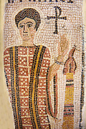 Detail of a fifth century AD Eastern Roman Byzantine  Christian  funerary mosaic of of a little girl The fragmentary inscription is at the top: (name of the deceased) who lived 4 years 11 months, 3 days 7 hours. The deceased is featured in a praying attitude, wearing an embroidered dalmatic. A monogrammed cross and a lit candle accompany the funerary idealised portrait. <br /> Christian necropolis of the Mezghani mounds in the Roman province of Africa Proconsularis  (present day Sfax, Tunisia) Fifth c. A.D. <br /> <br /> <br /> The Bardo National Museum Tunis, Tunisia