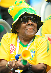 A Brazil fan shows his support ahead of the match