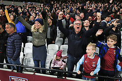 5 May 2017 - Premier League - West Ham v Tottenham Hotspur - West Ham fans celebrates as a young girl declines to join in, continuing to play on her tablet - Photo: Marc Atkins / Offside.