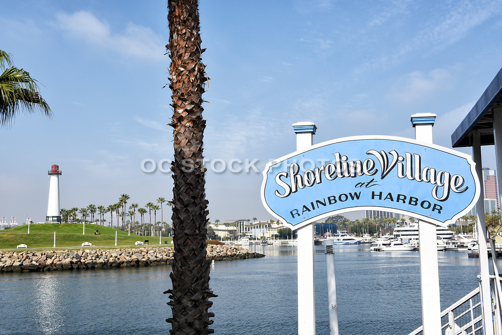 Shoreline Village Sign at Rainbow Harbor with Lighthouse in the <br /> Background
