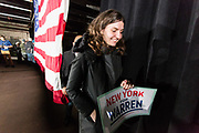 "Long Island City, NY – 8 March 2019. Massachusetts Senator and Democratic Presidential candidate Elizabeth Warren drew an enthusiastic crowd at an organizing rally for her 2020 presidential campaign in Long Island City. A woman enters the venue prior to the event carrying a sign that reads ""New York Cor Warren."""