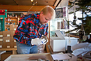 25 FEBRUARY 2010 -- WINSLOW, AZ: Kenn Evans II (CQ KENN WITH 2 n), a Park Ranger II, packs artifacts at Homolovi Ruins State Park north of Winslow. The park closed on Feb 22. The park's employees will spend the next few days packing up the park's exhibits but worry that the park's vulnerable archeological sites will be plundered by vandals and relic hunters when the park is vacant.    PHOTO BY JACK KURTZ