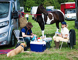 © Licensed to London News Pictures.15/08/15<br /> Rosedale, UK. <br /> <br /> A couple sit next to their horse and have a picnic during the Rosedale Country Show. This mainstay annual event remains as popular as ever attracting visitors and entrants from across the region.<br /> <br /> Photo credit : Ian Forsyth/LNP