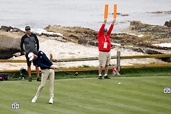 June 12, 2019 - Pebble Beach, CA, U.S. - PEBBLE BEACH, CA - JUNE 12: PGA golfer Dustin Johnson tees off on the 18th hole during a practice round for the 2019 US Open on June 12, 2019, at Pebble Beach Golf Links in Pebble Beach, CA. (Photo by Brian Spurlock/Icon Sportswire) (Credit Image: © Brian Spurlock/Icon SMI via ZUMA Press)