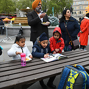 London, England, UK. 27 April 2019. Sikh family attend the  Vaisakhi Festival is a Sikh New Year in Trafalgar Square, London, UK.