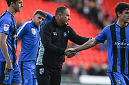 Steve Lovell of Gillingham (Manager) shakes the hands and thanks his players for their efforts after drawing 3-3 at Doncaster during the EFL Sky Bet League 1 match between Doncaster Rovers and Gillingham at the Keepmoat Stadium, Doncaster, England on 20 October 2018.