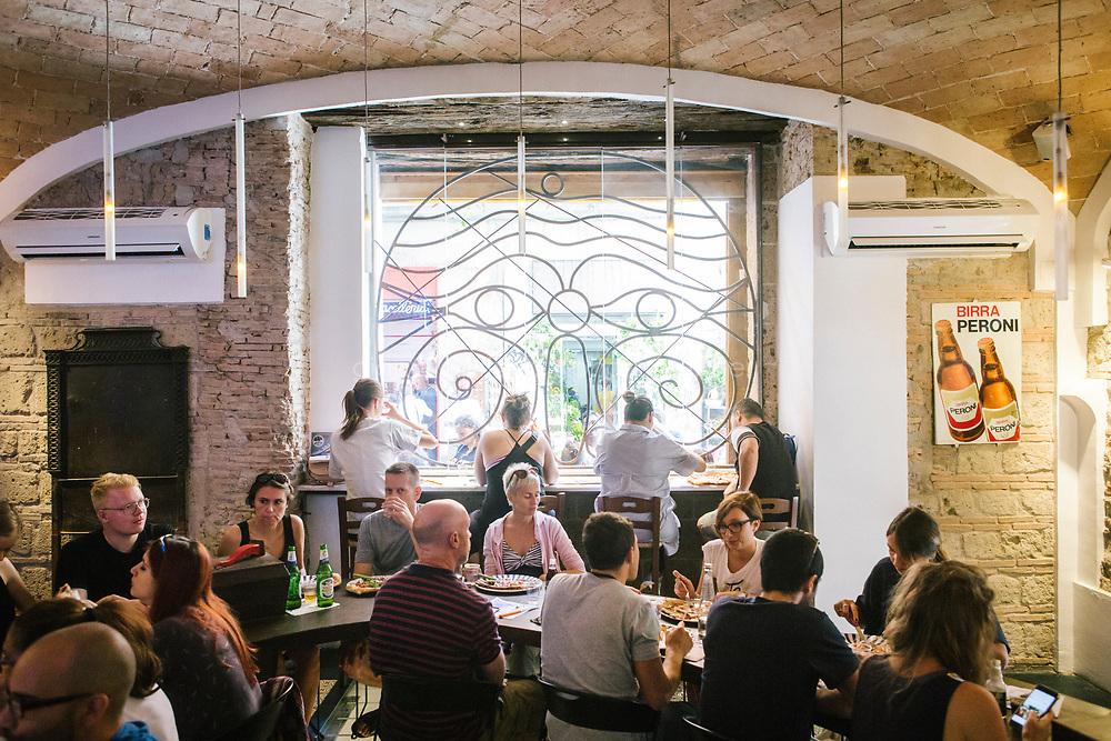 NAPLES, ITALY - 16 SEPTEMBER 2017: at Pizzeria Sorbillo in Naples, Italy, on September 16th 2017.