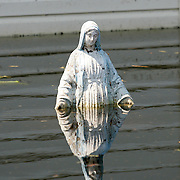 NEW ORLEANS, LA - September 4, 2005:  A statue of the Virgin Mary is visible above the water on a completely submerged street in New Orleans, Louisiana on Sept. 4, 2005. (Photo by Todd Bigelow/Aurora)....