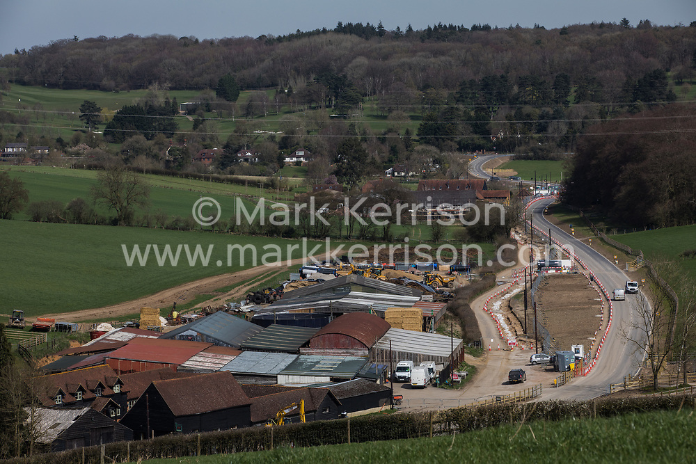 Chalfont St Giles, UK. 30 March, 2021. A general view of a temporary haul road constructed in connection with works for a ventilation shaft for the Chiltern Tunnel section of the HS2 high-speed rail link. The works, off Bottom House Farm Lane, include the construction of the ventilation shaft and an embankment as well as the temporary haul road.
