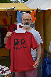 © Licensed to London News Pictures. 05/08/2016. WILDERNESS FESTIVAL, CORNBURY PARK, OXFORDSHIRE, UK.  Kevin Hodgetts sold the T shirt to Mark Carney, Governor of the Bank of England at the Wilderness Festival. .  Photo credit: MARK HEMSWORTH/LNP