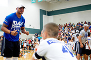 Dak Prescott works with kids during his summer football camp in Corinth, Texas on June 24, 2017. (Cooper Neill for The Players Tribune)