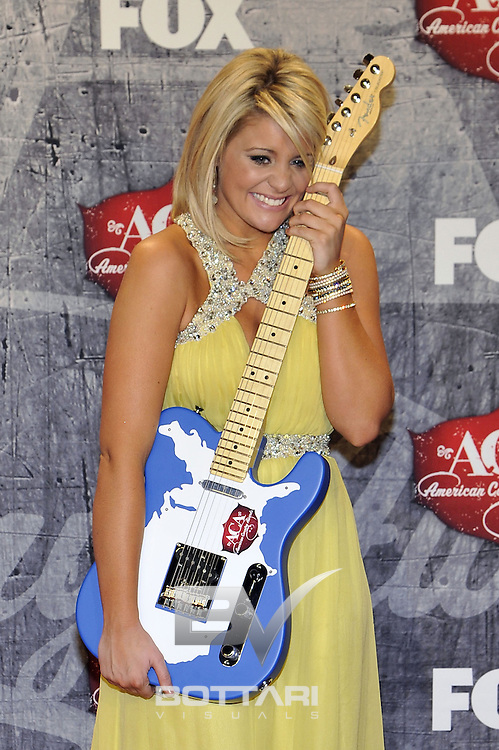 Singer Lauren Alaina poses in the press room with her award for New Artist of the Year backstage at the American Country Awards on Monday, Dec. 10, 2012, in Las Vegas. (Photo by Jeff Bottari/Invision/AP)