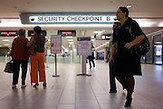 03 OCTOBER 2007 -- PHOENIX, AZ:  Passengers walk past Security Checkpoint 4 terminal 4 at Sky Harbor Airport in Phoenix, AZ.   PHOTO BY JACK KURTZ
