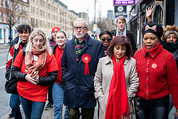 © Licensed to London News Pictures. 12/12/2019. London, UK. Labour Party Leader Jeremy Corbyn, his wife Laura Alvarez, and a group of supporters walk to Pakeman Primary School in North London to vote in the 2019 General Election. Photo credit: Rob Pinney/LNP