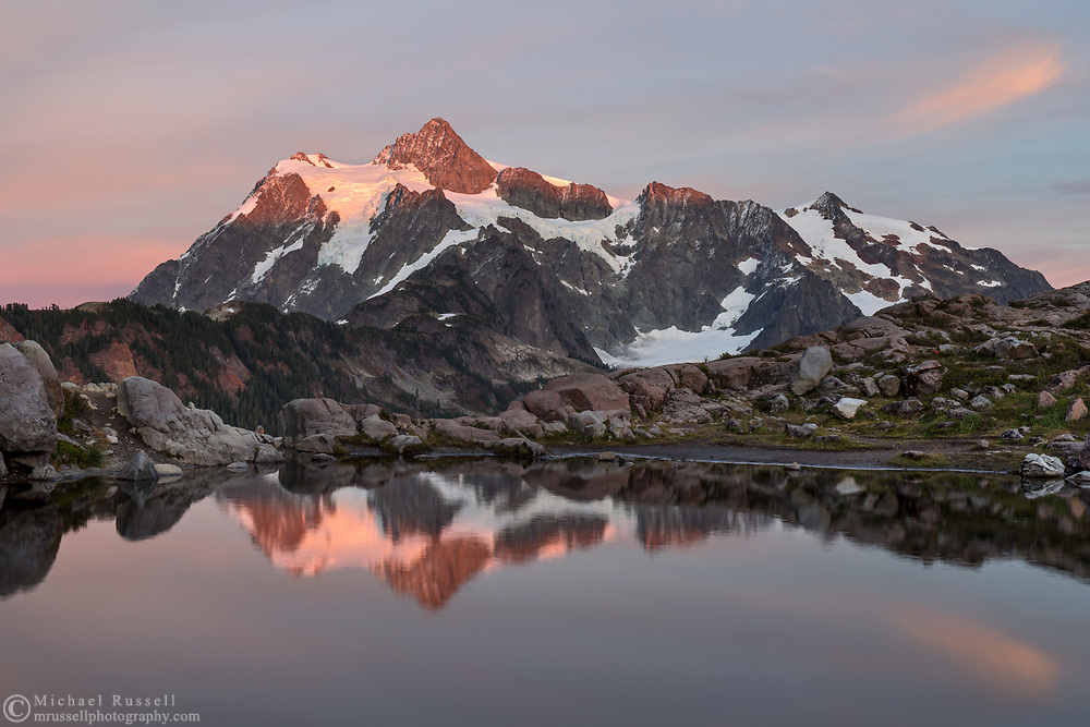 Sunset light on Mount Shuksan reflected in a tarn at Huntoon Point in the Mount Baker-Snoqualmie Forest, Washington State, USA.