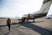 Iraan High School cheerleader Katie Kent walks to a plane donated to take her to the state championship game in Arlington after being injured in a bus accident that kept her from being able to ride the bus with the rest of the squad in Iraan, Texas on December 14, 2016. (Cooper Neill for The New York Times)
