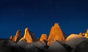 Eroded rock formations under a night sky in cappadocia, Turkey
