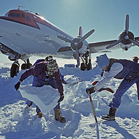 ANTARCTICA. Tourism, Mountaineers dig out stuck Adventure Network DC-4 near Patriot Hills tourist base.