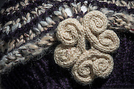 Close-up of hat and broach detail.