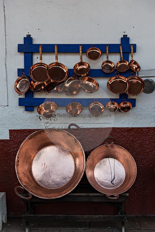 Copper pots and pans made by indigenous Purepecha coppersmiths on sale at a shop in Santa Clara del Cobre, Michoacan, Mexico. The Purepecha people have been crafting copper crafts since the 12th century.