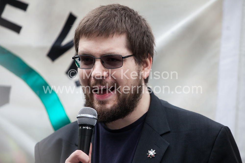London, UK. 3 May, 2019. Daniel Jacopovich, Peace and Disarmament Programme Manager at the Quakers in Britain, addresses campaigners from the Campaign for Nuclear Disarmament (CND), Stop the War Coalition, the Peace Pledge Union, the Quakers and other faith groups protesting outside Westminster Abbey against the holding of a National Service of Thanksgiving to mark fifty years of the Continuous at Sea Deterrent (CASD) attended by dignitaries including the Duke of Cambridge and the newly appointed Defence Secretary Penny Mordaunt.