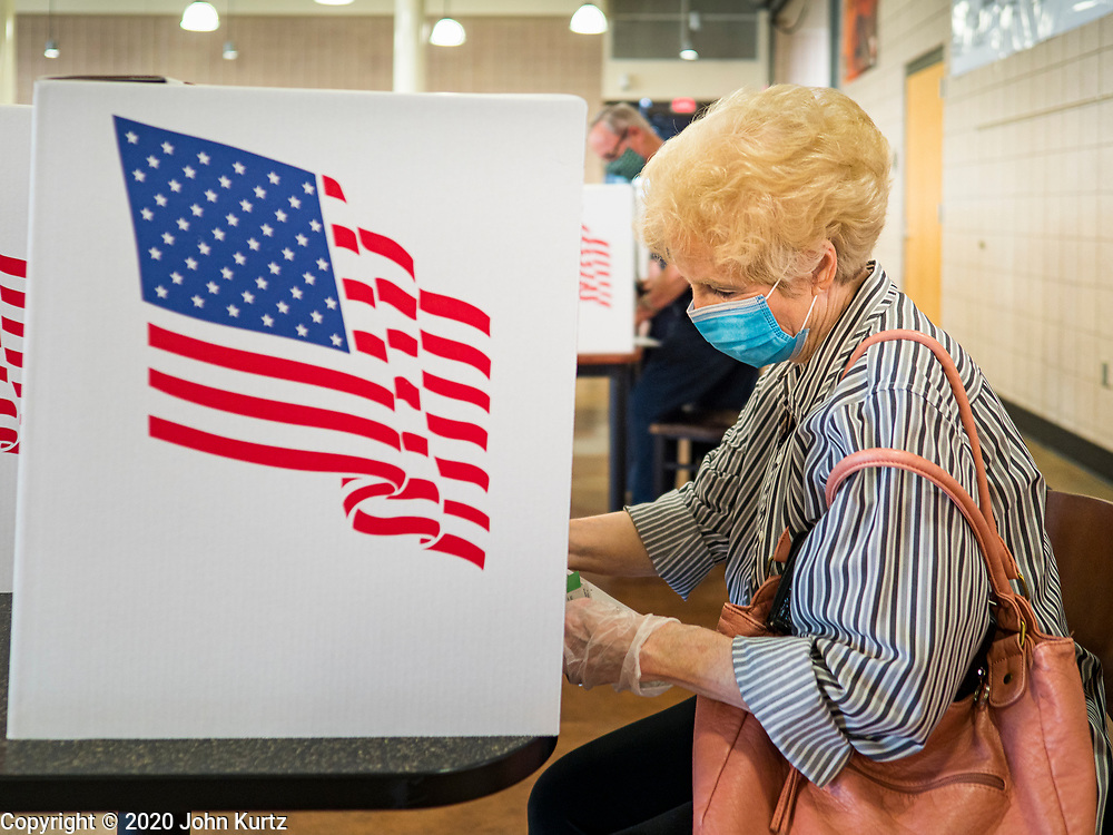 02 JUNE 2020 - WEST DES MOINES, IOWA: TERRI JOHNSON, from West Des Moines, votes on primary election day at Valley High School in West Des Moines. She said she was going to vote by mail but decided to vote in person because her son is on the ballet and it was the first time she was able to vote for her son. Because of the Coronavirus pandemic, all of the polling places in West Des Moines were consolidated to Valley High School, where voting booths were set up with social distancing in mind and booths were sanitized before they were reused. Although Iowa uses a caucus system to select presidential candidates, they use a primary election to select candidates for other offices. Statewide, the most watched race Tuesday is the Democratic Senate primary to select a candidate to run against Republican incumbent Joni Ernst.      PHOTO BY JACK KURTZ