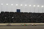 Greg Biffle (16) Danica Patrick (10) and Jeff Gordon (24) enter turn one during a NASCAR Sprint Cup series night race, Saturday, May 10, 2014, at Kansas Speedway in Kansas City, Kan. (AP Photo/Colin E. Braley)