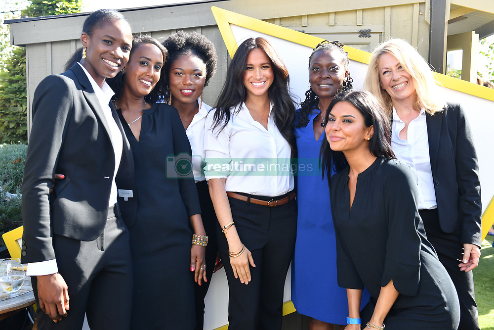 The Duchess of Sussex (centre) launches the Smart Works capsule collection at John Lewis in Oxford Street, London. PA Photo. Picture date: Thursday September 12, 2019. The series of outfits that can be worn in the workplace have been created in aid of Smart Works, a charity which provides training and interview clothes to unemployed women in need, and has Meghan as its royal patron. See PA story ROYAL Meghan. Photo credit should read: Mark Large/Daily Mail/PA Wire