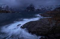 Storm waves crash over coastal rocks at Hamnøy, Moskenesøy, Lofoten Islands, Norway