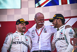 May 12, 2019 - Barcelona, Catalonia, Spain - VALTTERI BOTTAS (FIN) and LEWIS HAMILTON (UK) from team Mercedes celebrate their teams victory with Mercedes-Benz CEO DIETER ZETSCHE (M) at the Spanish GP on the podium at the Circuit de Barcelona - Catalunya (Credit Image: © Matthias Oesterle/ZUMA Wire)
