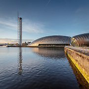 The titanium clad Glasgow Science Centre designed by BDP in 2001 with the fully rotating Glasgow Tower designed by Richard Horden in 2001, Glasgow, Scotland.