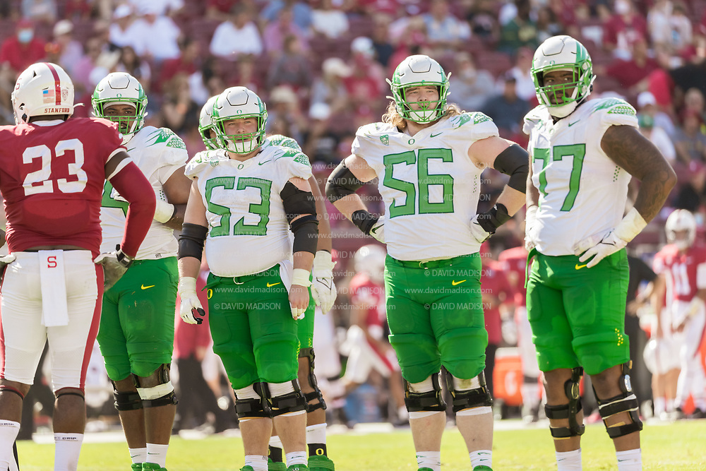 PALO ALTO, CA - OCTOBER 2:  The Oregon Ducks offensive line including Ryan Walk #53, T.J. Bass #56, and George Moore #77 look to the sidelines during an NCAA Pac-12 college football game against the Stanford Cardinal on October 2, 2021 at Stanford Stadium in Palo Alto, California.  (Photo by David Madison/Getty Images)