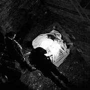 Police examine the body of one of the victims who jumped from the fatal fire at 611 West 148 Street in Harlem on Tuesday, July 8, 2008.