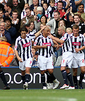 Photo: Mark Stephenson.<br /> West Bromwich Albion v Queens Park Rangers. Coca Cola Championship. 30/09/2007.West Brom's Kevin Phillips celebrates his goal; with Paul Robinson (R) and Robert Karon (L)