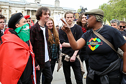 © Licensed to London News Pictures. 01/05/2019. London, UK. Friction between the two women at the annual May Day Rally on International Workers' Day in Trafalgar Square. Labour Day in some countries and often referred to as May Day, is a celebration of labourers and the working classes that is promoted by the international labour movement which occurs every year on May Day (1 May), an ancient European spring festival. Photo credit: Dinendra Haria/LNP