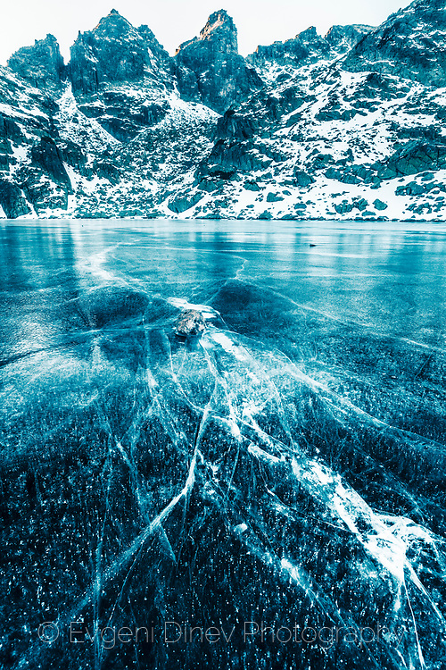 Mountain lake covered in ice