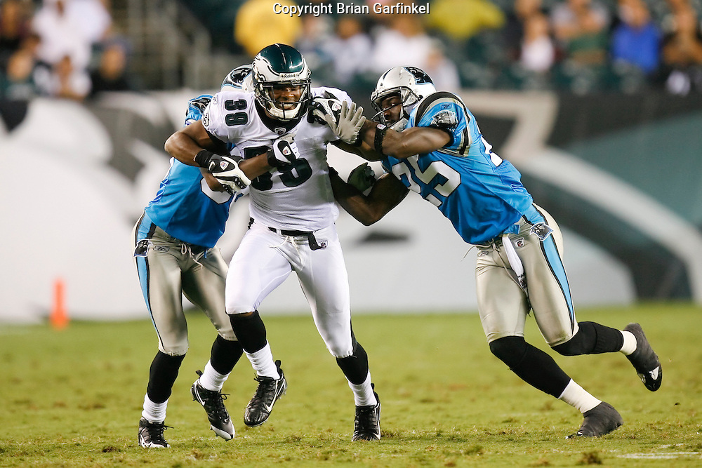 8 August 2008: Philadelphia Eagles safety Quintin Demps #39 is blocked by two Carolina Panthers on a punt during the game against the Carolina Panthers on August 14, 2008. The Eagles beat the Panthers 24 to 13 at Lincoln Financial Field in Phialdelphia, Pennsylvania.