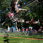 Children enjoy fun rides during the May Fair at Saint Mark's Church, New Canaan, Connecticut, USA. 12th May 2012. Photo Tim Clayton