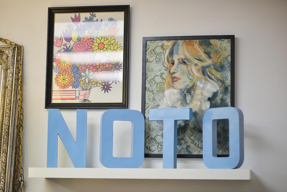 Framed art at NOTO Boutique.